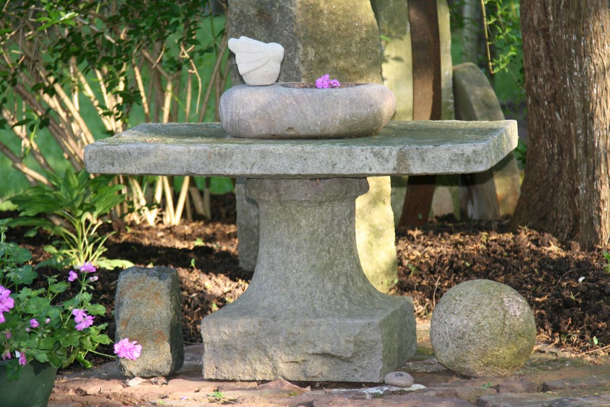 Birdbath on Formal Stone Table